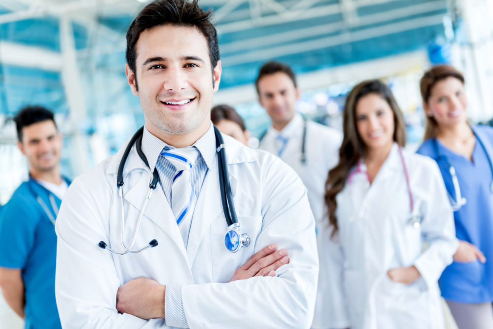 Man leading a group of doctors at the hospital